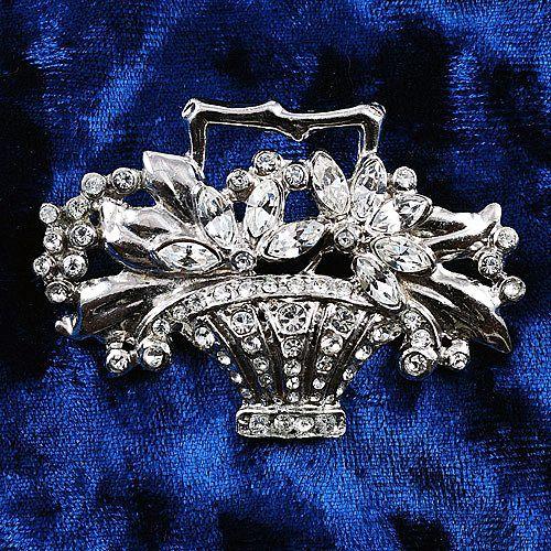 Gorgeous crystal rhinestone flower basket brooch in Silver tone