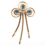 Retro gold tone brooch with turquoise rhinestones and dangling chains