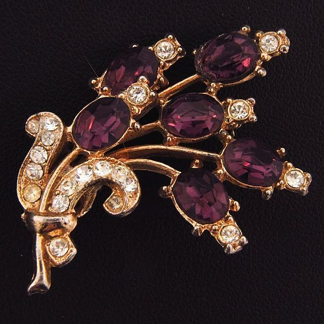 Vintage floral spray brooch with deep purple and colorless rhinestones