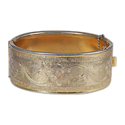 Lovely wide cuff etched floral design bracelet in gold tone