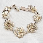 Silver wire floral bracelet marked 800 MP