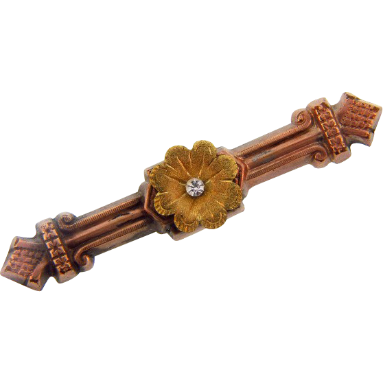 Lovely Edwardian gold tone bar pin with center flower