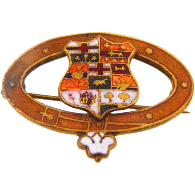 Early C clasp enamel oval brooch with center coat of arms