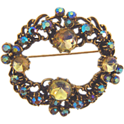 Signed Florenza circular brooch with citrine cabochons and blue AB rhinestones