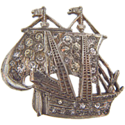 Figural sailing ship brooch with crystal rhinestone.