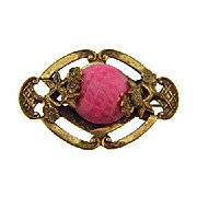 Early C clasp small brooch with center molded glass cabochon
