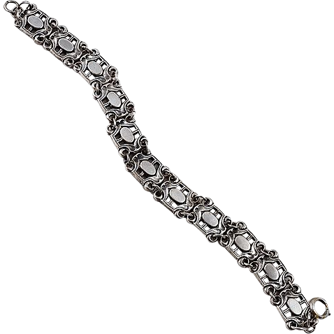 Silver tone bracelet shield shaped links