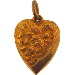 Gold tone puffy heart charm