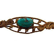 Edwardian bar pin with center blue stone