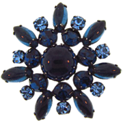 Vintage shades of blue rhinestone Brooch set in gun metal finish frame.