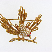 Figural vintage gold tone Bird Brooch with imitation pearl body