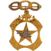 Early metal or emblem featuring a peace dove atop a star