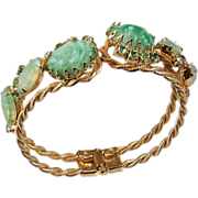 Clamper bracelet mottled green Cabochons braided gold tone frame