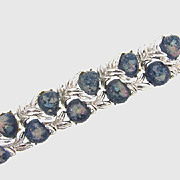 Chunky wide silver tone bracelet with blue lucite cabochons