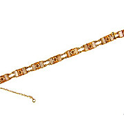 Delicate gold tone Damascene bracelet with opaque lucite links