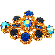 Marked Austria small bright gold tone Brooch with deep blue rhinestones