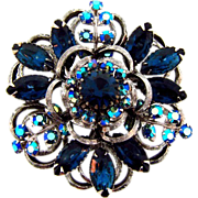 Signed Selini large silver tone brooch with AB and deep blue rhinestones