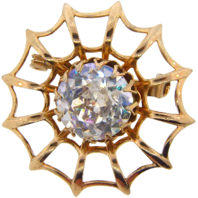 Cute vintage web design Brooch with center crystal faceted glass stone