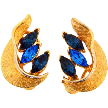 Vintage gold tone clip on earrings with blue glass rhinestones