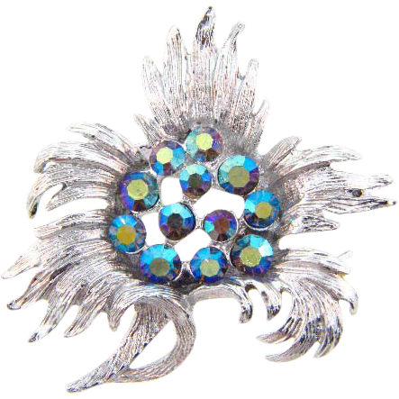 Silver tone floral brooch with blue AB rhinestones