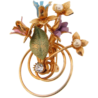 Springtime retro floral bouquet brooch with pastel enamel flowers and imitation pearls.