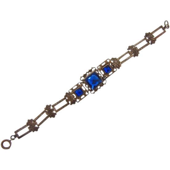 Lovely sterling silver early vintage bracelet with blue glass stones