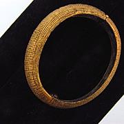 Signed Tortolani gold tone side clamper Bracelet