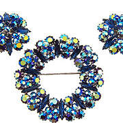 Signed Alice Caviness gorgeous rhinestone circular Brooch and clip on earrings
