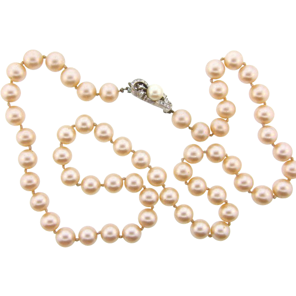 Signed Richelieu 24 inch single strand of champagne colored glass imitation pearl Necklace with rhinestone clasp.