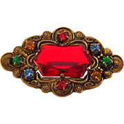 Early 1900's C clasp antiqued gold tone small Brooch with multicolored rhinestones