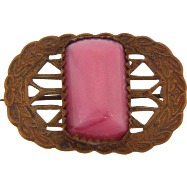 Small C clasp scatter pin with center raised pink glass stone