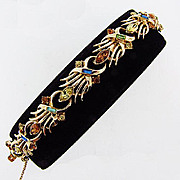 Lovely light gold tone 1960's  link bracelet with multicolored rhinestones