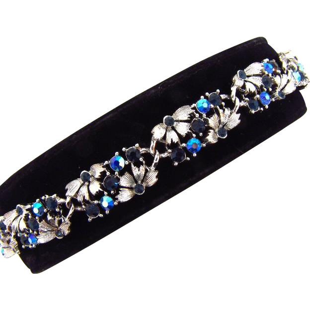 Signed Lisner floral link Bracelet with shades of blue rhinestones