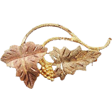 Marked 10K small gold brooch two tone leaf design