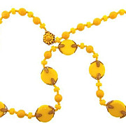 Signed Miriam Haskell bright yellow 28 inch long  bead Necklace with gold tone filigree findings