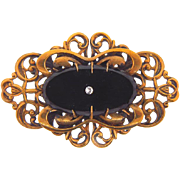 Elegant vintage Brooch in a lattice design with black glass oval cabochon and small crystal rhinestone