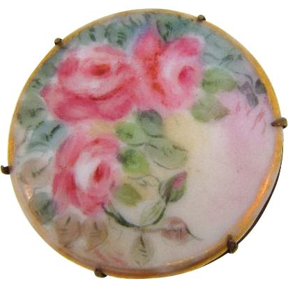 Early 1900's Edwardian porcelain hand painted floral round Brooch in C clasp brass frame