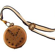 Vintage gold filled Locket with etched designed and darkened paste stones on original ribbon