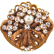 Signed Stanley Hagler, NYC small rhinestone and imitation pearl gold tone brooch