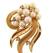 Signed Crown Trifari gold tone Brooch with imitation pearls and crystal rhinestones.