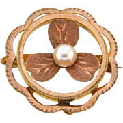 Circular Edwardian 1900's brooch with center shamrock and imitation pearl