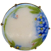 Small hand painted on porcelain floral scene Brooch