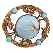 Signed C&R early unusual Brooch with dragons and blue glass beads