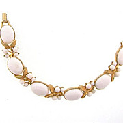 Signed Crown Trifari gold tone Bracelet with white composition cabochons and beads