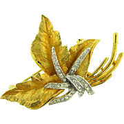 Beautiful floral Brooch with center rows of crystal rhinestones