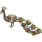 Vintage 1940's pot metal figural peacock Brooch with crystal rhinestones and composition brown moonstones