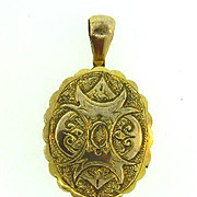 Larger heavy gold tone vintage locket with lock of blonde hair