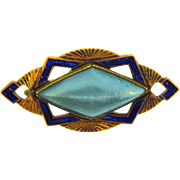 Small 1930's Art Deco brooch with raised celluloid center