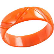 Pumpkin Bakelite Bangle 2 1/2 inch ID nice carvings