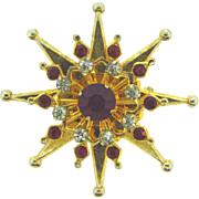 Signed Coro star shaped  Brooch with crystal and red rhinestones